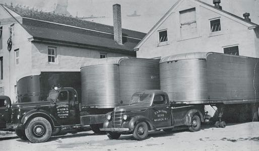 Trucks backed up to Warren plant in late 1940s.